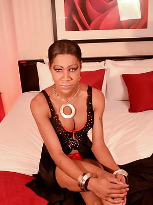 Seductive black hottie Babydoll stripping & posing